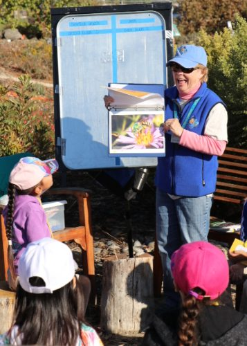 Master gardener teaching children